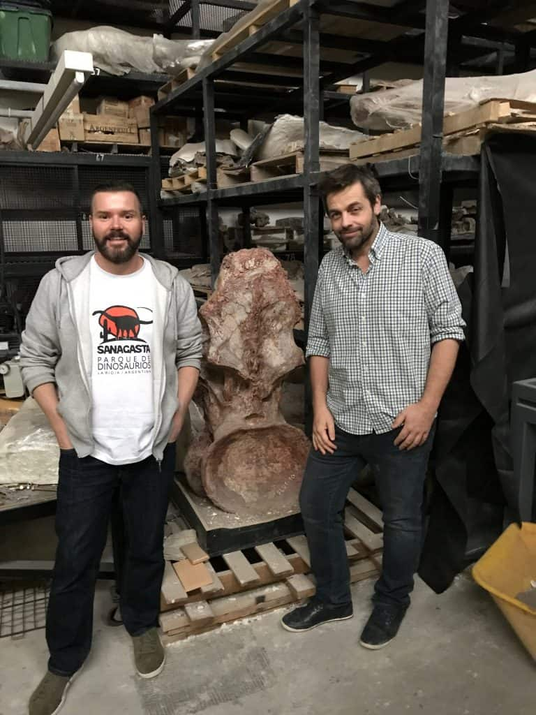 John and Dr Diego Pol with a backbone from Patagotitan, the largest of all known dinosaurs