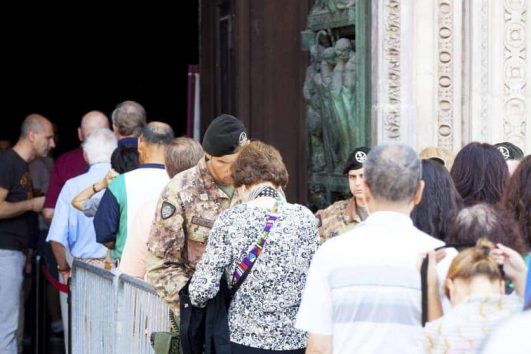 Crowds and Queues on holiday Milan