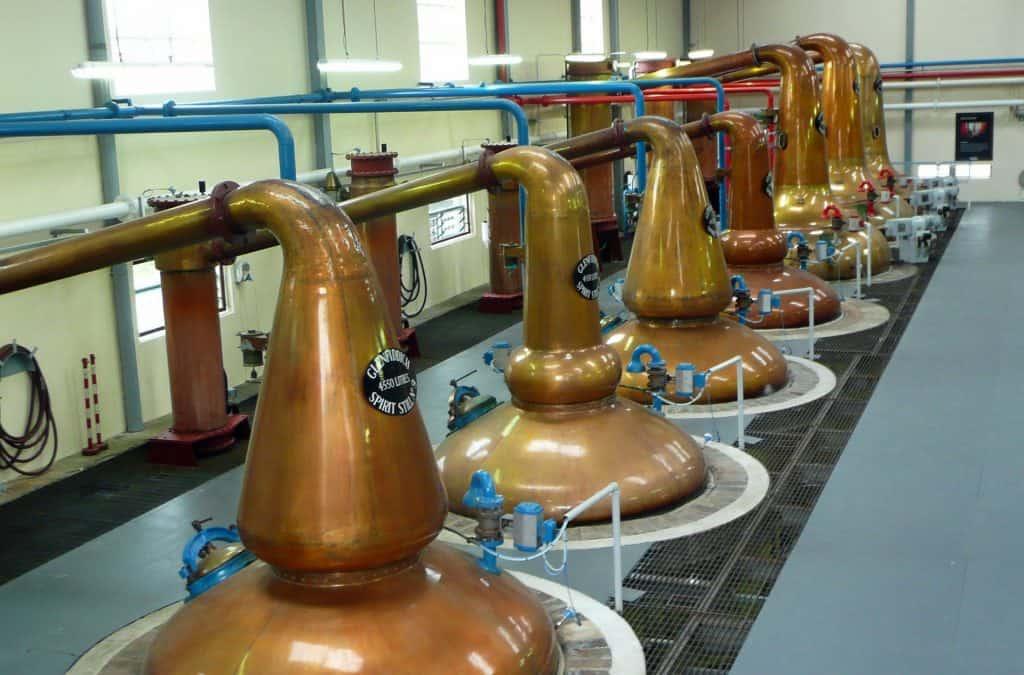 Modern pot stills in a distillery in Scotland