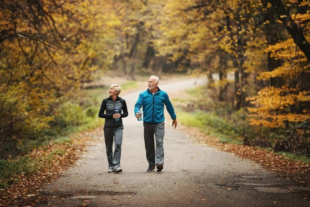 Senior couple power walking