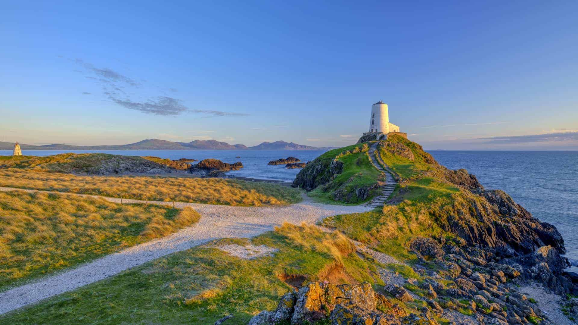 Twr Mar Lighthouse on Llanddwyn Island off Anglesey, Wales UK