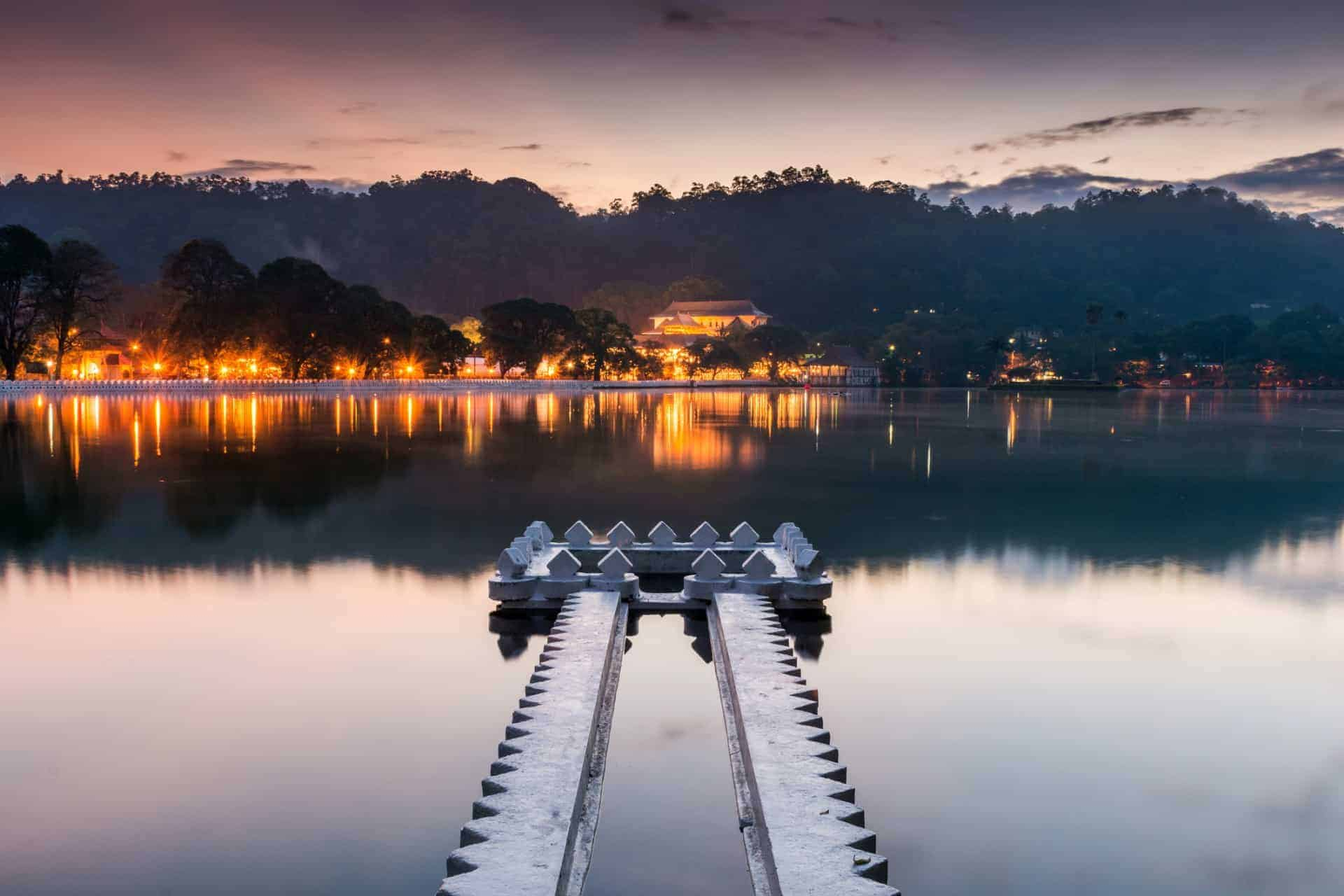 Kandy Lake and the Temple of the Sacred Tooth Relic (Sri Dalada Maligawa) at sunrise, Kandy, Sri Lanka