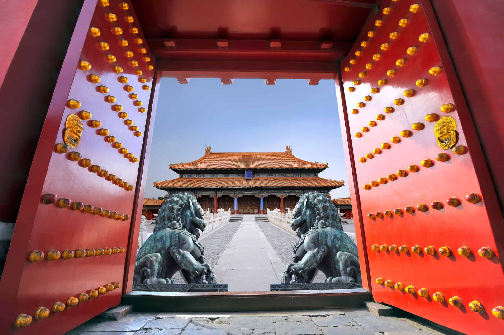 Red entrance gate opening to the forbidden city in Beijing - China