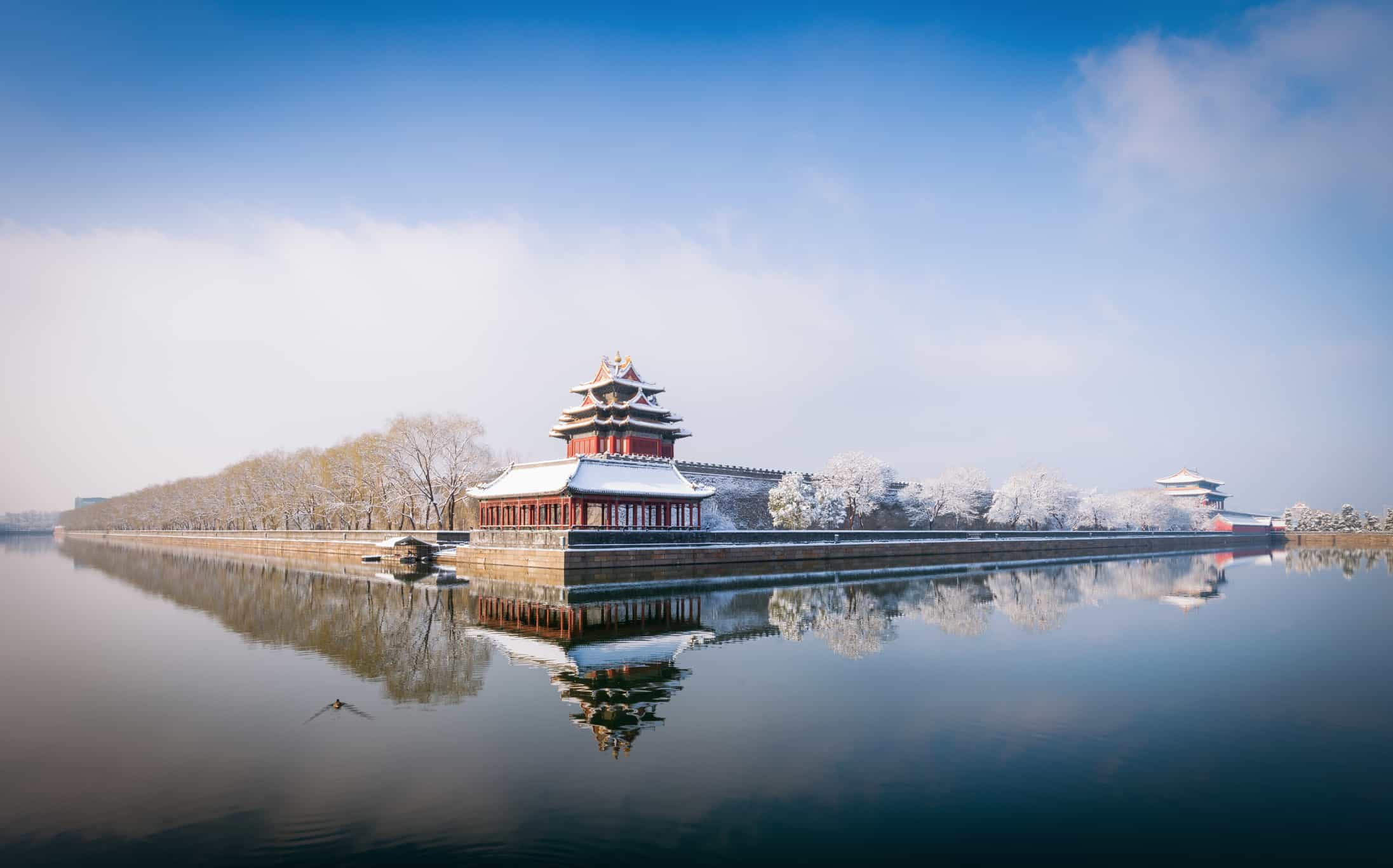 Snow on the North-East corner tower outside the Forbidden City in central Beijing.