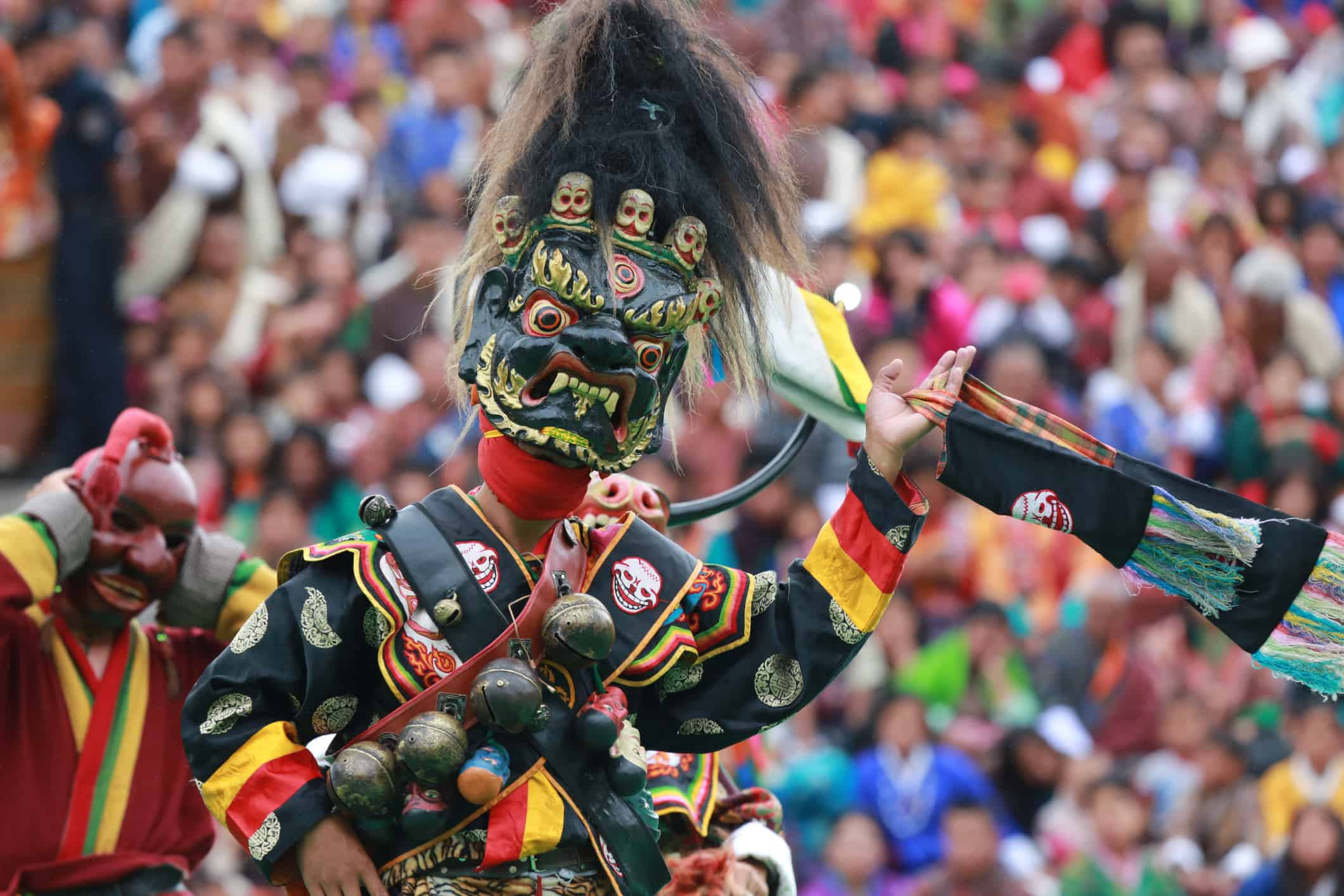Masked dance is one of the main attractions during annual festivals or Tshechu in Bhutan. It shows vibrant and unique cultural heritage.