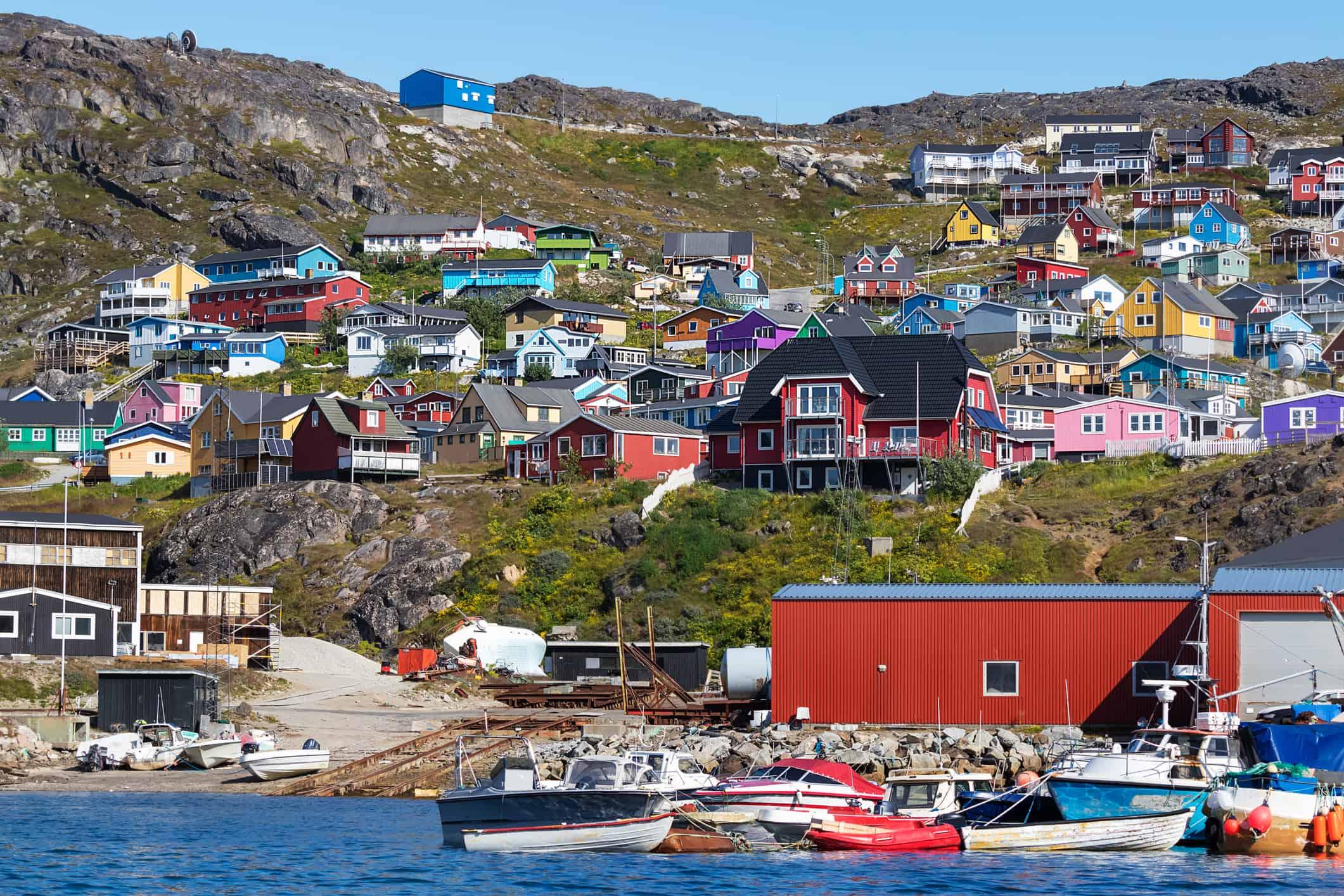 Colored houses on rocky hills in the coastline of Qaqortoq, Greenland.
