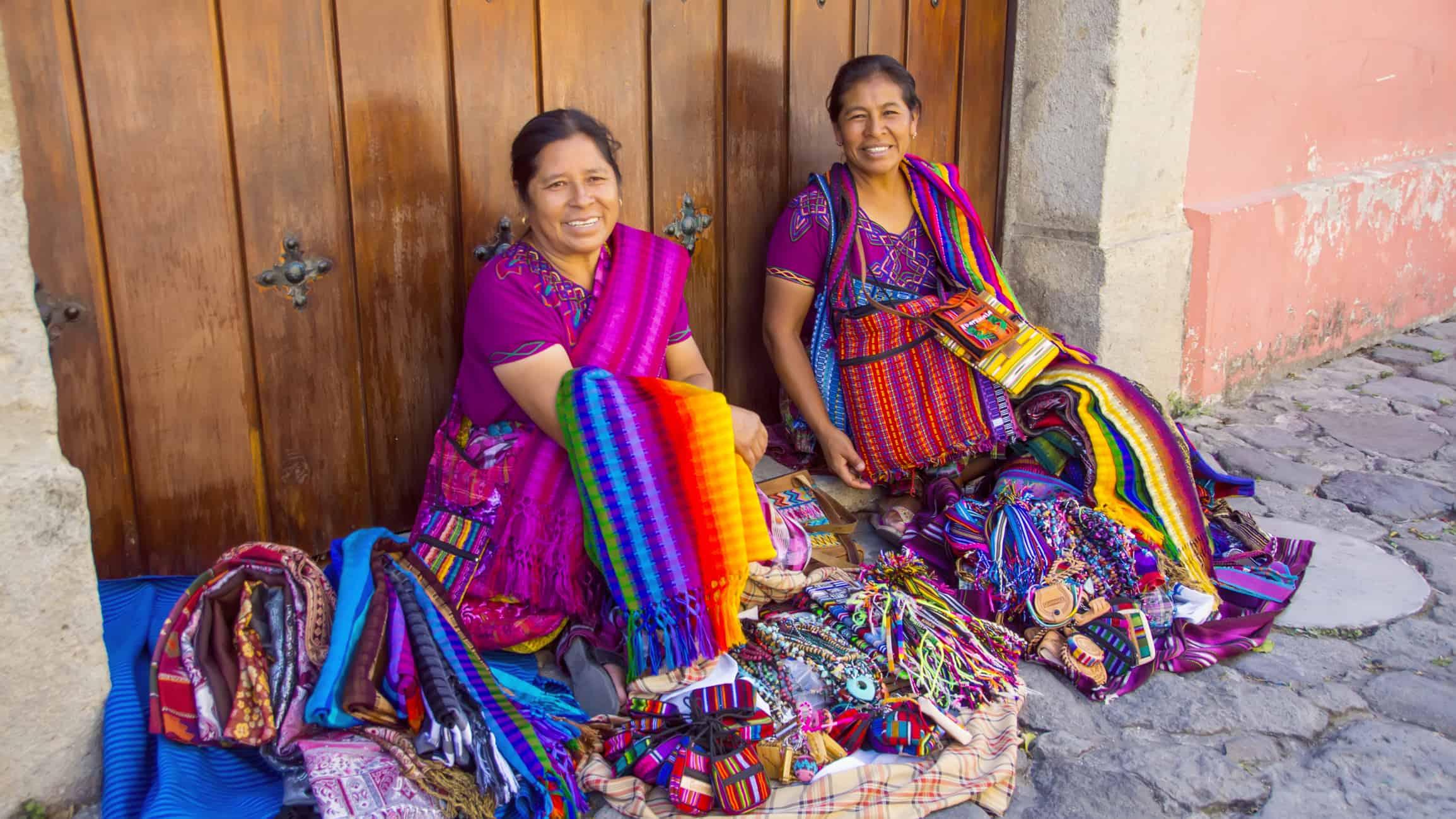 Mayan women selling handmade textiles and souvenirs, Antigua, Guatemala